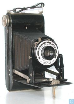 """KODAK Six-20 Folding Brownie Type Self-erecting folding rollfilm   Introduced: Jan 1937    Disc: 1940    Film size: 620  Picture size: 2 1/4 X 3 1/4""""  Manufactured: UK    Lens: Meniscus      Shutters: Kodette II                  Grained leatherette covering; folding frame finder,    from 1938.  While Eastman Kodak stopped making folding Brownies in 1926, Kodak Limited of the UK made a Six-20 Folding Brownie model which was on sale in the late 1930's and for a few years after the war."""