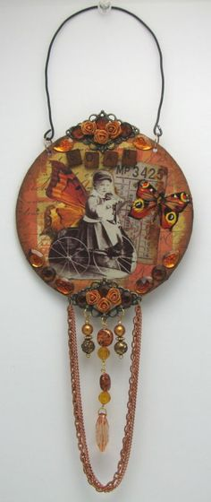 sold - Soar Wings Imagination Recycled CD Collage MixedMedia Altered Art Hanging Shabby