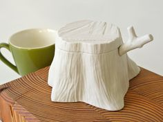 Tree Stump Salt/Sugar Cellar in white porcelain, unglazed finish. Comes with a twig spoon with clear glaze on the tip.  Salt/Sugar cellar : approximately 3 top width, 5.5 bottom width, 2.75 hight. Twig spoon : 4.5 long, Stem 3/8 width, Tip 1.25 x 1 width.