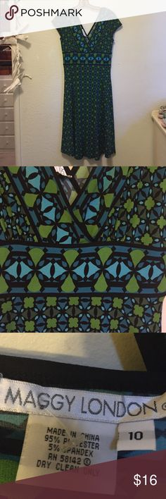 Green and Blue Dress Very nice Maggie London dress in excellent condition. Feminine cut and bold colors of green and blue in geometric pattern. Fits 8-12 because of the stretch. It is clean and does not require dry cleaning at this time. Comes from a smoke few home. Maggie London Dresses Midi