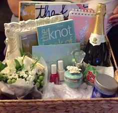 Engagement Basket I created for my best friend!   2 wedding magazines (the knot)  A frame for their favorite engagement photo   White flowers  Champagne   Essie nail polish (made sure to get wedding related names)  Jewelry cleaner  A box to hold her ring when she's not wearing it  2 wedding planning books to keep her organized during this amazing time A diamond wine stopper