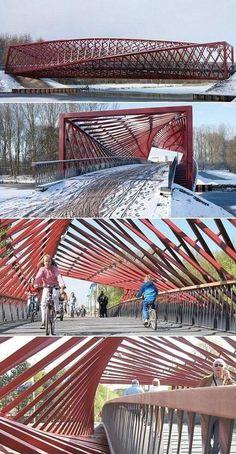 Vlaardingse Vaart Bridge (also called The Twist). Helical truss bridge for pedestrian and bicycle traffic in Vlaardingen, Netherlands. Completed in early 2009.
