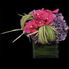 Phalenopsis orchids, purple hydrangea and grass flower arrangement