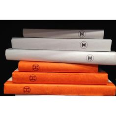 Indulge in your love of art and beautywith thesechic sets of decorative, parchment-hand bound books. Choose from a set of 3 orange or black and white. These