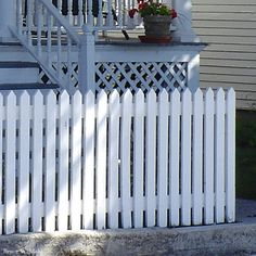 Simple straight picket fence, about 3 feet high.