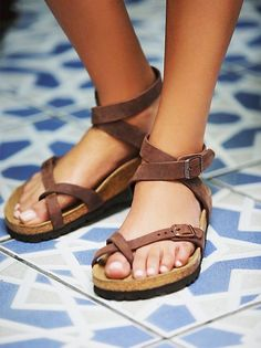 837087145ba7 Yara Birkenstock Elegant sandal with an adjustable ankle strap and toe  loop. Features the Birkenstock classic footbed and shock-absorbing EVA sole.