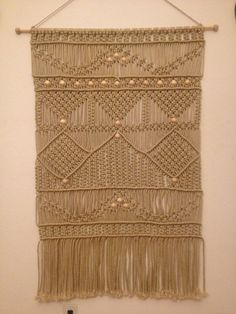 Handmade macrame wall hanging is unique panel for home decor.    Sizes:  width: 31  height:39  Along with tassels: 49    6 mm Bonnie Macrame