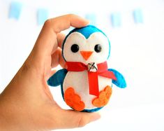 This item is a handmade felt penguin Christmas ornament. It is