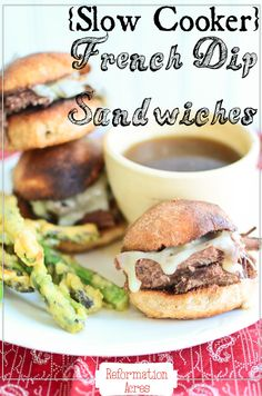 Slow Cooker French Dip Sandwiches- Slow cooker meals don't get more simple & delicious than this!