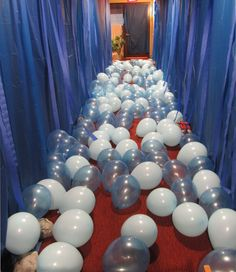 "Crossing of the Red Sea hallway for Sunday School lesson.  Blue tablecloths hung from the ceiling (gathered and taped up with duct tape), various color blue balloons representing water, as the kids walked thru, the waters separated so they could walk on ""dry land"". (also had a pillar of fire, and a pillar of cloud that was carried before and after them as they walked thru the waters of the Red Sea."