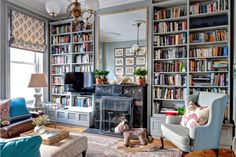 bookcases and giant mirror