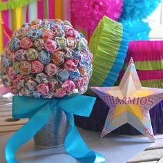 You could totally make this yourself for way less $. Dollar store flower pot, Styrofoam ball, ribbon (from a dollar store), dum dums. Done. Lollipop Bouquet l Candy Bouquet l Edible Arrangements l Birthday Bar Bat Mitzvah Wedding Party Centerpiece. $32.00, via Etsy.