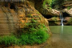 """Old Man's Cave,"" located at Hocking Hills State Park in southern Ohio, got its name from hermit Richard Rowe who made the large cave home in the early 1800s. Lush sandstone walls and waterfalls in Old Man's Cave"