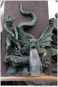 Dragon-dog figure on fountain outside Zürich Hauptbahnhof (Main Station). Altstadt (Old Town). Gothic Gargoyles, Dragons, Street Art, Ange Demon, By Any Means Necessary, Angels And Demons, Gremlins, Dragon Art, Green Man