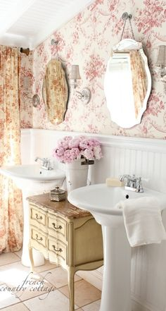 Romantic small master bath. Great job utilizing space. Love the wallpaper and window treatments. By having them match it makes the room seem larger!
