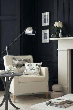 Black walls with beautiful furniture.