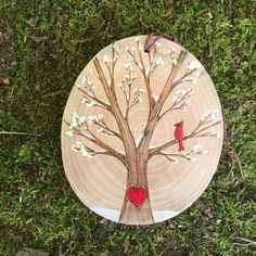 Snowy, winter tree with red cardinal and heart. Custom wood slice ornament or magnet. Personalized wood burned heart, with or without snow