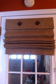 Burlap roman blind over door way in summer, this would keep the flies out but allow the breeze in!!