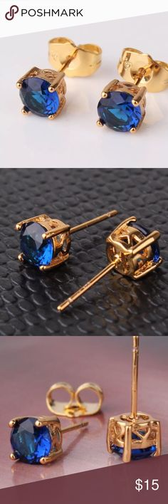 Royal Blue Sapphire Swarovski & 24K Gold Earrings Gorgeous royal blue Swarovski crystal stud earrings set in a 24K gold filled setting. Please see photo #4 for manufacturer's information on their gold filled vs. gold plating.  These are my favorite earrings and I own a number of pairs that are up to 3 years old and still look brand new. 6 mm stones.  Please feel free to ask me any questions you may have, & thank you for taking a look & sharing this listing!  GULICX Jewelry Earrings