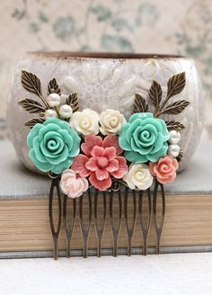 This is a gorgeous flower bridal hair comb in deep coral pinks, sea foam green, teal blue and ivory cream. This floral collage includes various