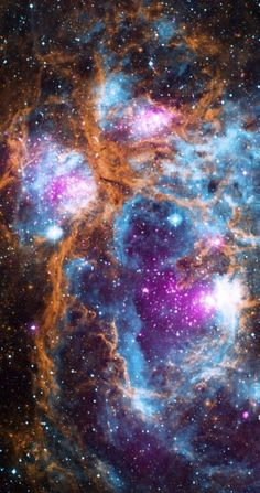 This composite image of NGC 6357 contains X-ray data from NASA's Chandra X-ray Observatory and the ROSAT telescope (purple), infrared data from NASA's Spitzer Space Telescope (orange), and optical data from the SuperCosmos Sky Survey (blue) made by the United Kingdom Infrared Telescope. Image credit: X-ray – NASA / CXC / PSU / L.Townsley et al; optical – UKIRT; infrared – NASA / JPL-Caltech.