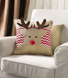 Reindeer Pillow Wrap  #4265056  Burlap pillow wrap has multi-layered felt reindeer appliqué and red pom-pom nose. Fastens with Velcro. Fits 15'' square pillow.