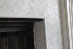 Great Pics Fireplace Remodel marble Thoughts How to Add Herringbone Marble Tile to a Fireplace – Southern Hospitality Paint Fireplace Tile, Tile Around Fireplace, Herringbone Fireplace, Marble Herringbone Tile, Wood Mantle Fireplace, Stone Fireplace Surround, Family Room Fireplace, Fireplace Bookshelves, Black Fireplace