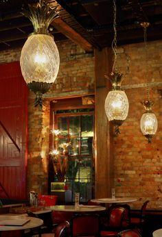 A richly decorated brasserie in Sydney's historic Rocks district blends Parisian flea-market finds, some exposed brick grit and a liberal splash of glamour. Pineapple Chandelier, Pineapple Lights, Lantern Light Fixture, Light Fixtures, Key West Decor, Tropical Decor, Interior Design Inspiration, Decoration, Pendant Lighting