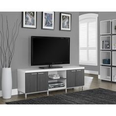 Designed to accommodate large flat-screen televisions, this console with built-in shelves and cabinets makes a great center for your entertainment equipment. This media stand offers a modern look enhanced by mixed materials.