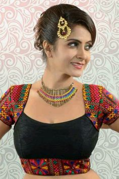 Buy Black multicoloured raw silk exquisite blouse with rounded square neck Online Saree Blouse Neck Designs, Stylish Blouse Design, Saree Blouse Patterns, Fancy Blouse Designs, Designer Blouse Patterns, Bridal Blouse Designs, Pattern Blouses For Sarees, Indian Blouse Designs, Versace