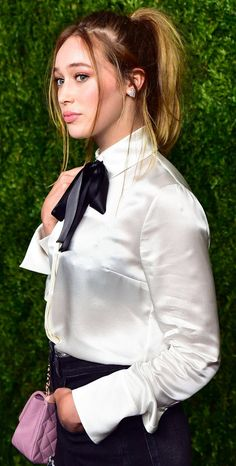 Dressed For Formal Occasion In White Blouse And Black Bow