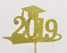 2019 Graduation centerpiece sticks, 2019 graduation party, class of 2019 centerpiece sticks, 2019 Grad sticks School Centerpieces, Graduation Centerpiece, Graduation Party Themes, School Decorations, Graduation Cards, Grad Parties, American Flag Decor, Fourth Of July Decor, Glitter Cards