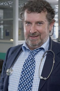 Paul Bradley as lovable, surgical master Prof. Elliot Hope, Holby City