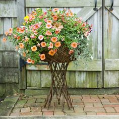 """Woven from natural willow, this expandable garden structure is the perfect showcase for blooming plants or a drop-in basket.- Willow branches, galvanized metal nails- Imported26-37""""H, 4-17"""" diameter"""