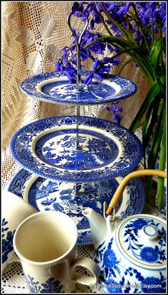 """Churchill's famous Blue Willow pattern three tier handmade cake stand using best quality vintage English made china plates with most loved and desired exquisite pattern in blue and white, for all admires, lovers and collectors to bring that """"chic cottage"""" touch of high style to your tea ceremony. Have a closer browse for other inspiring ideas for your tea party at Posh&Seductive Etsy boutique store."""