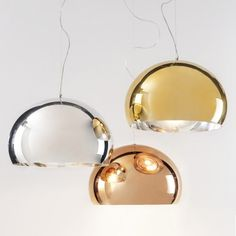 The Precious FL/Y Suspension Lamp is a luminous surprise — like a metallic bubble, iridescent in the reflection of the light. Composed of PMMA and offered in three metallic finishes, FL/Y is available individually, but is suitable for hanging in groups of three or more to enhance its delicate chromatic variations.