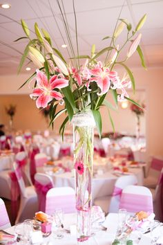 Tall glass vase table center piece with pink lily