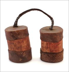 * Fat container, Himba, Namibia. Made of cow horn. Fat containers store a combination of ochre and butterfat, used to adorn the body. These traditional ochre and butterfat containers are a necessary accessory for all Himba women. Women collect the gum of the omazumba shrub (Commiphora multijuga) to perfume the butterfat and the bark of the omumbara (Commiphora virgata) to grind into an aromatic powder to mix with the ochre before smearing it on their bodies.