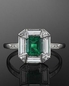 Vintage Jewelry 1920 Platinum Emerald and Diamond Ring, c. A square emerald weighing approximately carats is set in a halo of baguette and triangular diamonds in a platinum mounting. Anel Art Deco, Art Deco Ring, Art Deco Jewelry, Fine Jewelry, Jewelry Design, Jewelry Rings, Jewlery, Jewellery Box, Jewellery Shops