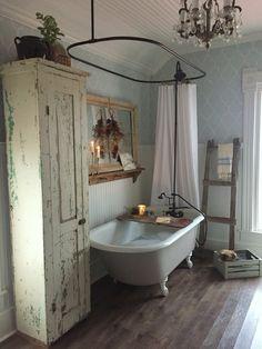 Amazing farmhouse vintage bathroom with claw foot tub