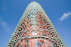 """Jean Nouvel  Agbar Tower  Barcelona, Spain, 2005.   The exterior of the tower is a complicated surface of colored metal panels surrounded by a framework of fixed glass louvres fritted with ceramic dots. Those cause the metal to appear slightly blurred and """"liquid""""."""