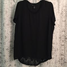 """Layne Bryant top Black top with crochet embellishment around neckline. Entire back has a lace/crochet look. Back hangs approx 4"""" lower than front. Size 18/20. Beautiful top! Tops Blouses"""