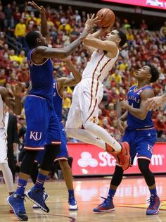 Cliff Alexander trying to put a stop to Naz Long of Iowa State Cyclones while Devonte Graham longs on -  January 17, 2015 -