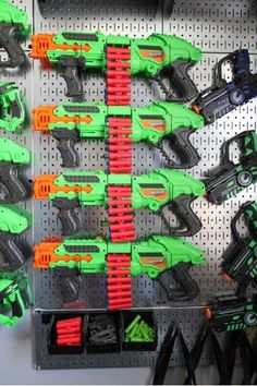 Metal Pegboard Nerf Gun Storage. Easy for Kids to use. Even store bullets in hanging bins! We never want you to stop sending us your Nerf Walls. Donna is ready for battle! 🔫 Nerf Gun Storage, Metal Pegboard, Tool Organization, Office Walls, Bullets, Battle, Store, Easy, Kids