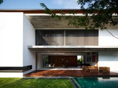 "Singapore-based architectural firm ONG&ONG has completed the M House project in 2011. This contemporary two-story home is located in Bukit Timah, an area in Singapore located near the centre of the Singapore main island.               M House by ONG&ONG: ""Nestled in Bukit Timah, this home provides the ideal balance between the needs for family bonding as well as for personal space. Despite housing numerous bedrooms, communal areas are spacious with a double-volume void in the living area…"