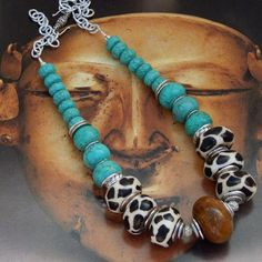 Beaded Jewelry Add stunning statement accessories This African inspired necklace features Kenyan giraffe-print batik beads huge focal is Chinese serpentine and turquoise magnesite Separating each of the beads are silver discs and I Love Jewelry, Tribal Jewelry, Wire Jewelry, Boho Jewelry, Beaded Jewelry, Handmade Jewelry, Jewelry Necklaces, Jewelry Making, Gold Bracelets