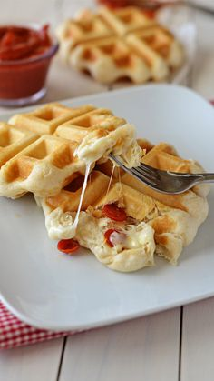 Stuffed Pizza Waffles! Pillsbury Grand biscuits stuffed with cheese and pepperoni and cooked in a waffle iron! - Life In The Lofthouse