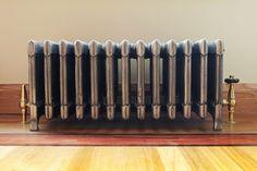9 Column 340mm cast iron radiator in Full Polish. Installed in Fitzrovia by Dothgro Bespoke Furniture & Carpentry.