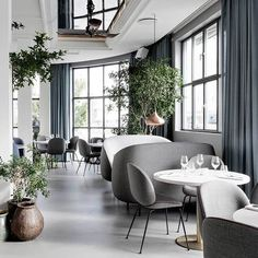 The Standard. Simple monochrome interior with soft lines and textures create a tranquil interior. The plants help to keep the space from feeling too stark.