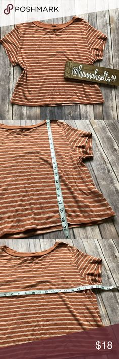 Urban Outfitters BDG Striped Tee Size Medium Like new orange and cream striped tee from Urban Outfitters. This top is slightly cropped so it looks great with high waisted jeans. This is perfect for Fall layering! 💠From a clean and smoke free home!💠 Add to a bundle to get a private discount💠Free Gift with $25+ Purchase 💠 Discount ALWAYS Available on 2+ items💠 No trades, holds, modeling or transactions off of Poshmark.💠 Urban Outfitters Tops
